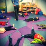 Kids doing yoga with Sligo WArrior