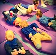 Kids on yoga mats doing yoga with Sligo Warrior
